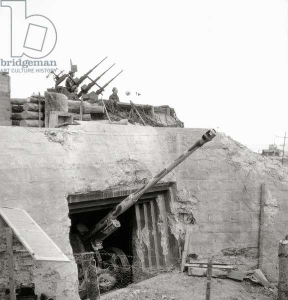 R669, a former German bunker (WN 29) that housed a 88mm tank gun (East End) is now used by the Canadians as an anti-aircraft position, Courseulles-sur-Mer, Normandy, France, June 1944 (b/w photo)