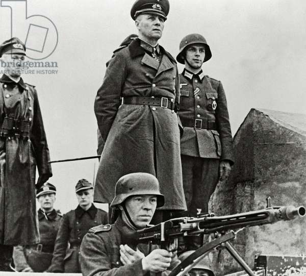 General Erwin Rommel is inspecting the coastal defence system with a group of German officers, Normandy, France, 1944 (b/w photo)