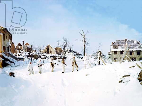 Six United States soldiers from the 7th Armored Division patrolling St. Vith during the Battle of the Bulge, also known as the Ardennes Offensive or the Von Rundtstedt Offensive, Belgium, January 1945 (photo)