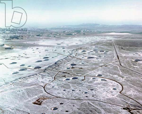 The crater-scarred landscape of the Nevada Test Site (photo)