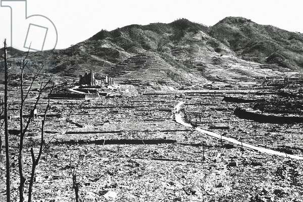 The only recognisable structure remaining is a ruined Roman Catholic Cathedral in the background on a destroyed hill, Nagasaki, Japan, August 1945 (b/w photo)