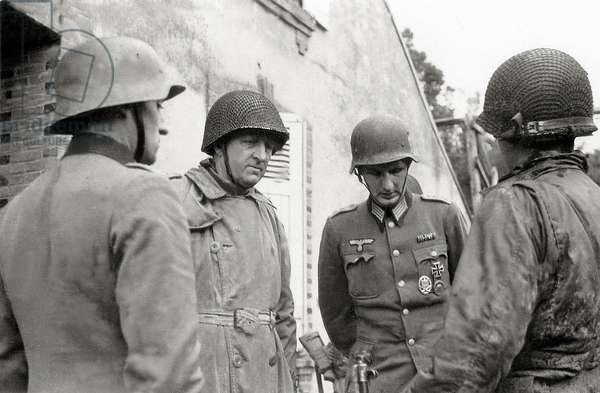 Two German prisoners with two American officers, Cherbourg, Normandy, France, 26th June 1944 (b/w photo)