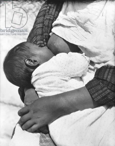 Baby nursing (Conchita with her mother Luz Jimenez), Mexico City, 1926 (b/w photo)