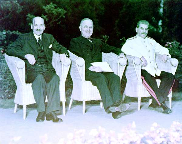 The Big Three: Prime Minister Clement Attlee, President Harry S. Truman and Joseph Stalin, seated outdoors at Cecilienhof during the Potsdam Conference, Germany, 1st August 1945 (photo)