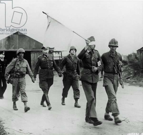 Three German officers have been taken prisoner and are being led back after talks with American officers near Brest, Brittany, France, 20th September 1944 (b/w photo)