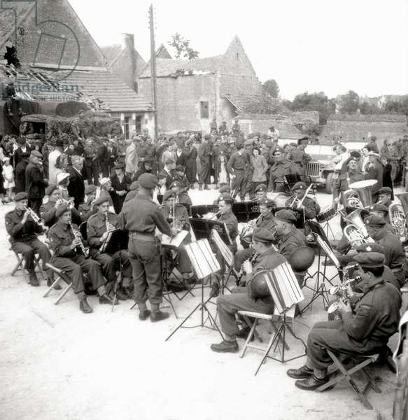 A group of the 2nd Canadian Infantry Division plays during celebrations, Rots, Normandy, France, 14th July 1944 (b/w photo)