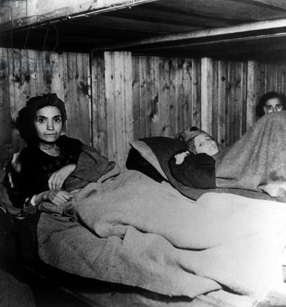 Three of the 600 Jewish women from Hungary who worked in an aeroplane factory in Penig concentration camp, a sub-camp of Buchenwald, 12th April 1945 (b/w photo)