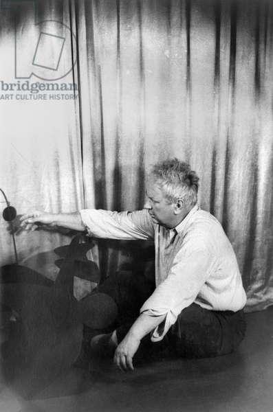 ALEXANDER CALDER (1898-1976) American sculptor. Photographed by Carl Van Vechten, 1947.
