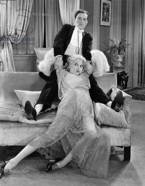 BUSTER KEATON (1896-1966) American comedian. With Thelma Todd in 'Speak Easliy,' 1932.