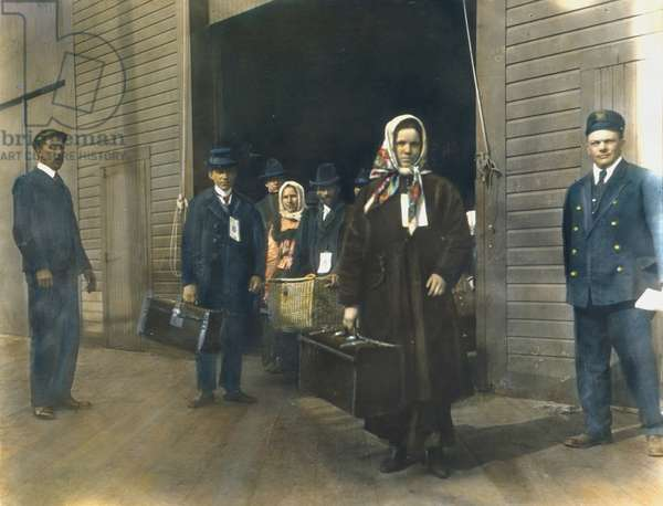 EUROPEAN IMMIGRANTS leaving Ellis Island. Oil over a photograph, c. 1900.