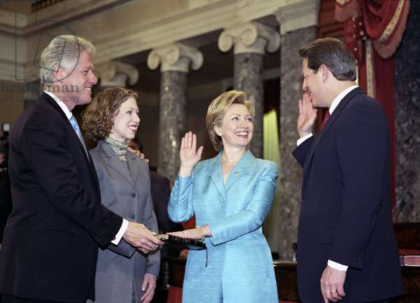 HILLARY RODHAM CLINTON (1947- ). American politician. Being sworn in as a senator by Vice President Al Gore, as President Bill Clinton and Chelsea Clinton look on. Photograph, 2001.
