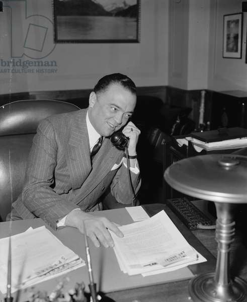 JOHN EDGAR HOOVER (1895-1972). American lawyer and public official. Photographed in his office as Director of the F.B.I., April 1940.