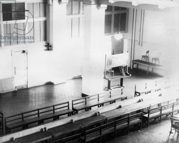 ELLIS ISLAND, c.1943 The visitors section (in the former registry room) for 'enemy aliens' detained on Ellis Island during World War II. Photograph, c.1943.