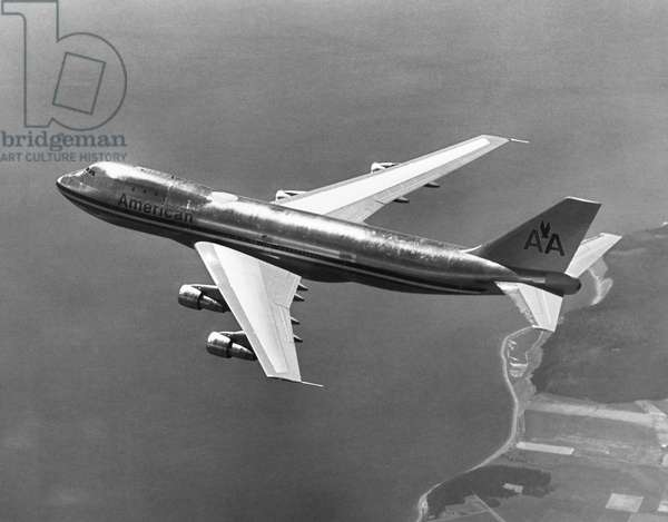 BOEING 747 AIRPLANE A Boeing 747 airplane operated by American Airlines, in flight. Photograph, late 20th century.