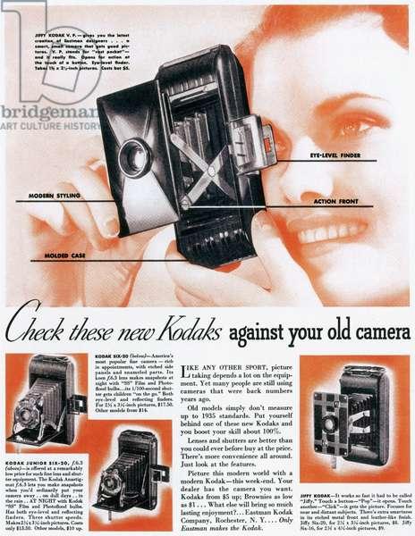 KODAK ADVERTISEMENT, 1935 Advertisement for three new models of Kodak cameras, from an American magazine, 1935.