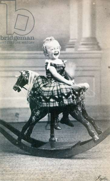 ROCKING HORSE, c.1870 A young girl on a rocking horse. Original carte-de-visitie photograph, Canadian, c.1870.