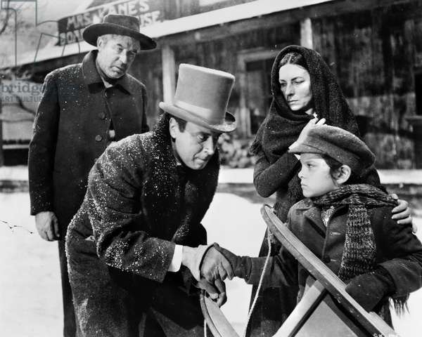 CITIZEN KANE, 1941 Buddy Swann (right) as Charles Foster Kane in his boyhood, shaking hands with banker Walter Parks Thatcher (George Coulouris), in the presence of Kane's mother (Agnes Moorehead) and father (Harry Shannon), in a scene from the film 'Citizen Kane,' 1941.