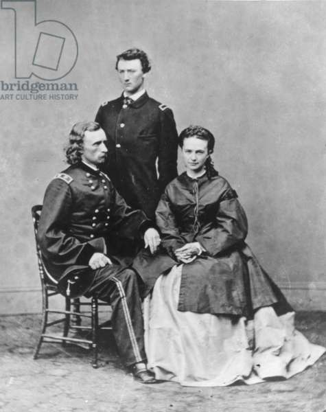 GEORGE ARMSTRONG CUSTER (1839-1876). American army officer. Custer (seated wearing the uniform of a major general) with his wife, Elizabeth, and brother, Tom: photographed by Mathew Brady in 1865.