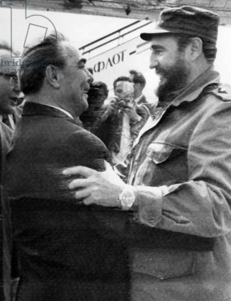 FIDEL CASTRO (1926- ) Cuban revolutionary leader. Castro (right) is greeted by Communist Party General Secretary Leonid Brezhnev upon his arrival at Moscow's Vnukovo Airport, 26 June 1972.