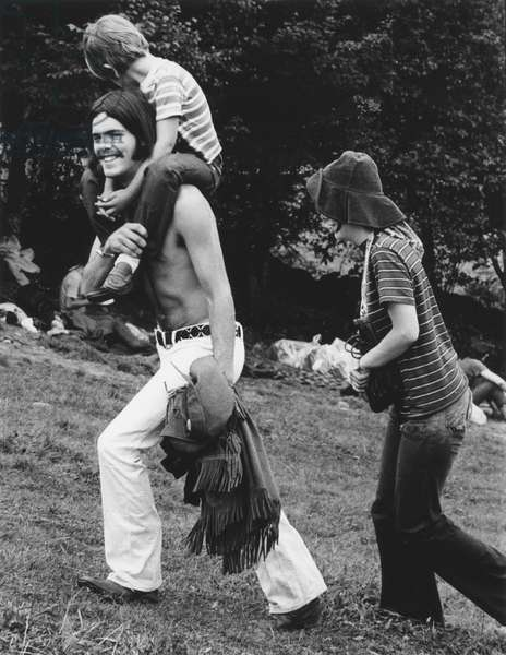 HIPPIE MOVEMENT, 1969 Hippie couple with their son at the Woodstock rock concert in upstate New York.