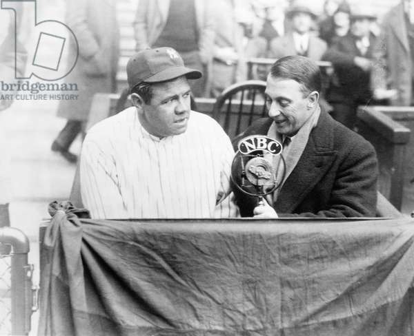 GEORGE H. RUTH (1895-1948) Known as Babe Ruth. American professional baseball player. Babe Ruth interviewed by Graham McNamee between innings at a Yankee baseball game in the 1930s.