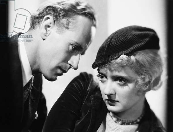 BETTE DAVIS (1908-1989) American actress. Bette Davis and Leslie Howard in the leading roles in 'Of Human Bondage,' 1934.