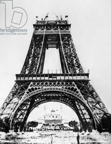 EIFFEL TOWER: CONSTRUCTION Building the Eiffel Tower on the Champ de Mars in Paris, France, for the Universal Exposition of 1889. The Palais de Trocadero can be seen in the background. Photograph, late 1888.