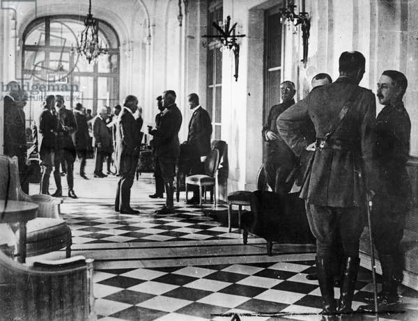 VERSAILLES TREATY, 1919 Delegates waiting in a hallway in the Palace of Versailles in France, during the peace treaty negotiations, June 1919.
