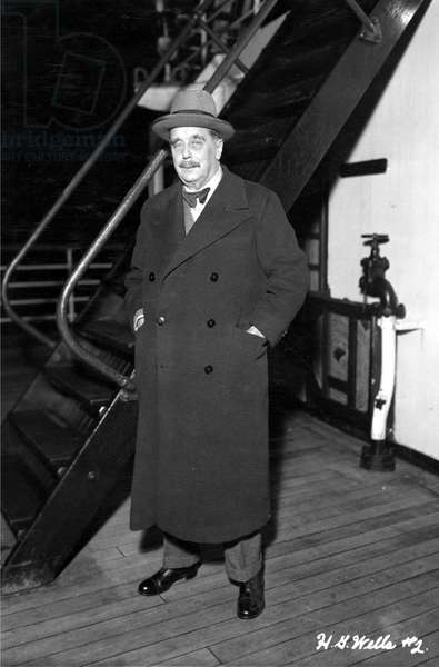 HERBERT GEORGE WELLS (1866-1946). English writer. Photographed arriving in New York by ship in 1936.