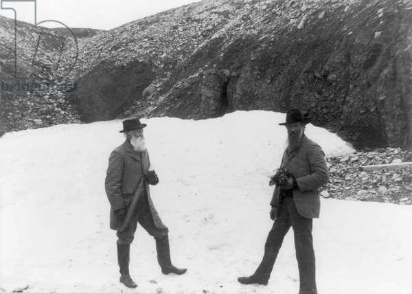 MUIR & BURROUGHS, c.1899 American naturalists John Muir and John Burroughs. Photographed c.1899.