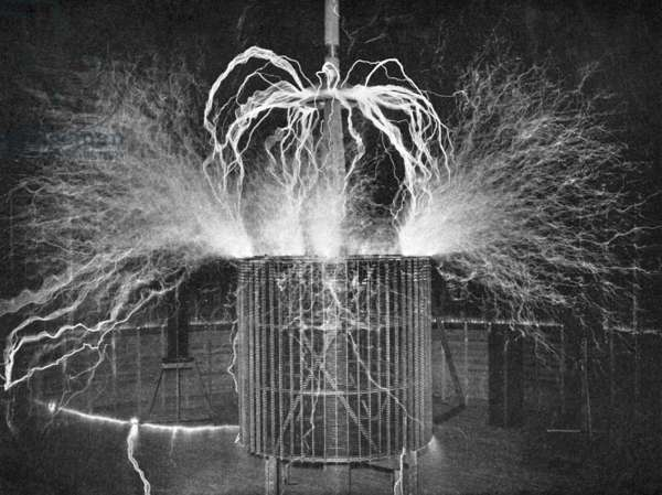 TESLA'S LABORATORY, c.1900 Burning the nitrogen of the atmosphere in an experiment in Nikola Tesla's laboratory in Colorado Springs, Colorado. Photograph by Dickenson V. Alley, c.1900.