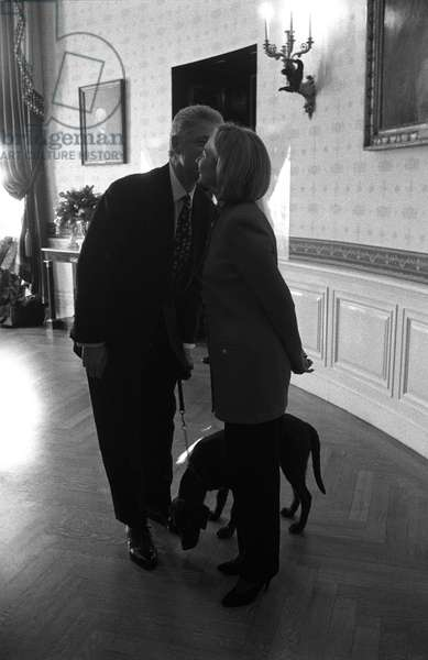 THE CLINTONS, 1997 President Bill Clinton, First Lady Hillary Rodham Clinton with Buddy the Dog in the White House in Washington, D.C. Photograph by Barbara Kinney, 1997.