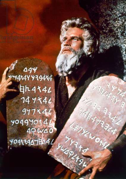 TEN COMMANDMENTS, 1956 Charlton Heston as Moses on a poster for the film 'The Ten Commandments' directed by Cecil B.DeMille, 1956.