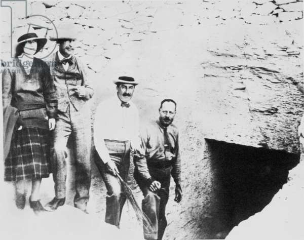 HOWARD CARTER (1873-1939) English archaeologist. Lady Evelyn Herbert, her father Lord Carnarvon, Howard Carter and A.R. Callender at the entrance to the tomb of King Tutankhamen in the Valley of the Kings, Egypt, 1922. Photographed by Harry Burton.