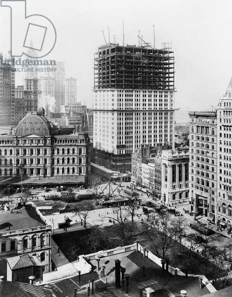 WOOLWORTH BUILDING, 1912 Partially constructed lower section of the Woolworth Building amidst smaller buildings, New York City. Photograph, c.1912.