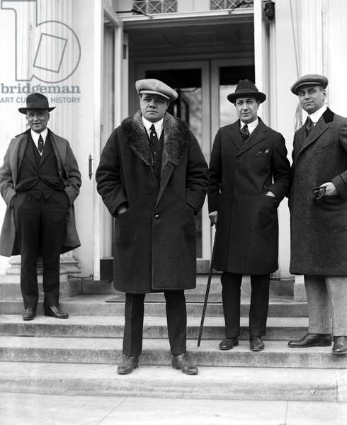 GEORGE H. RUTH (1895-1948) Known as Babe Ruth. American professional baseball player. Ruth (center) photographed outside the White House in Washington, D.C., 1921.