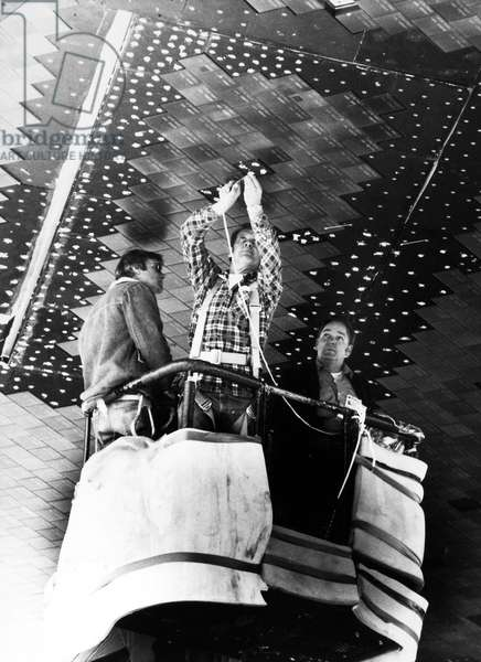 NASA SPACE SHUTTLE, 1979 Workers apply a special adhesive to reinforce the foam tile on the underside of the Space Shuttle Orbiter 'Columbia' at NASA's Dryden Flight Research Center, California before its launch from Kennedy Space Center, Florida, 1979.