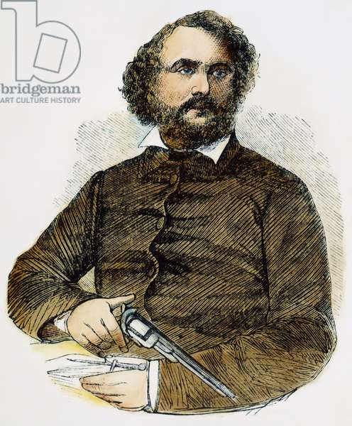 SAMUEL COLT (1814-1862) American inventor; with a gun: wood engraving, 1856.