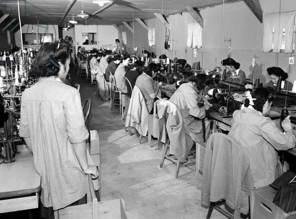 JAPANESE INTERNMENT, 1943 Sewing factory at the Manzanar Relocation Center at Owens Valley, California. Photographed by Ansel Adams, 1943.