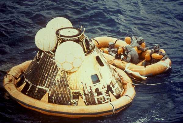 APOLLO 11: SPLASHDOWN Apollo 11 astronauts Neil Armstrong, Michael Collins, and Edwin 'Buzz' Aldrin in a dingy after splashing down in the Pacific Ocean, 24 July 1969.