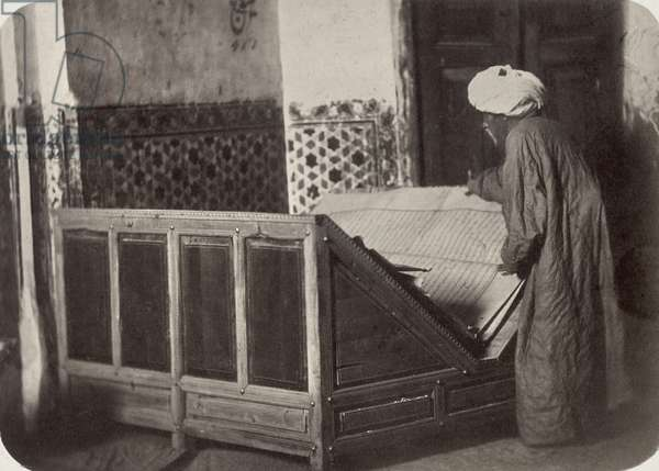 SAMARKAND: KORAN, c.1870 Tomb of Saint Kassim ibn Abbas (Sheikh Zinde) in the mosque of Shakh Zinde. Reading-stand with a Koran donated by Emir Nasrulla of Bukhara. Photograph by N.V. Bogaevskii, c.1870.