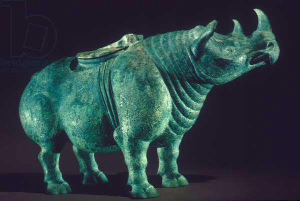 CHINA: BRONZE RHINOCEROS Bronze wine vessel in the shape of a rhinoceros. Eastern Zhou, 475-220 B.C.