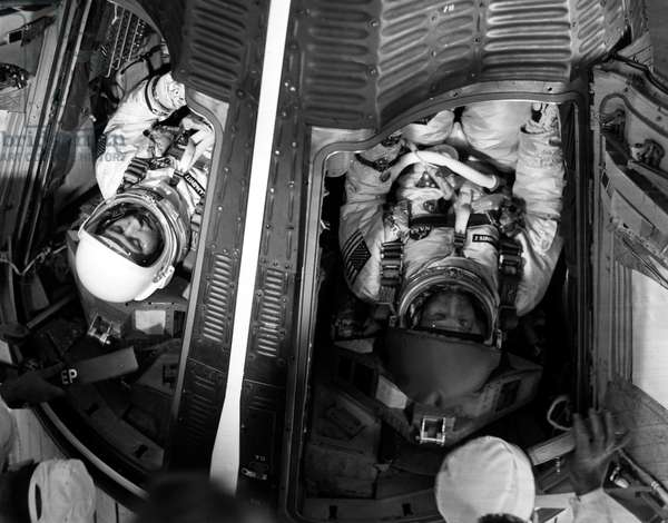 GEMINI IV: ASTRONAUTS, 1965 Astronauts James McDivitt, command pilot (left) and Edward White are loaded into the Gemini IV spacecraft just before launch, 3 June 1965.