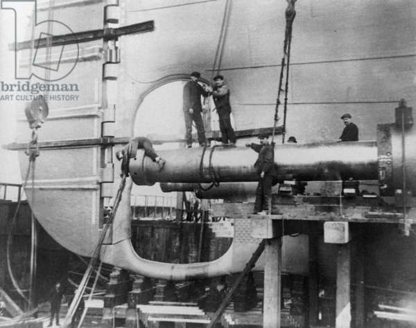TITANIC: CONSTRUCTION, 1912 Workers assembling the propeller shafts of the RMS 'Titanic' at Harland & Wolff shipyard in Belfast, Ireland. Photograph, c.1912.