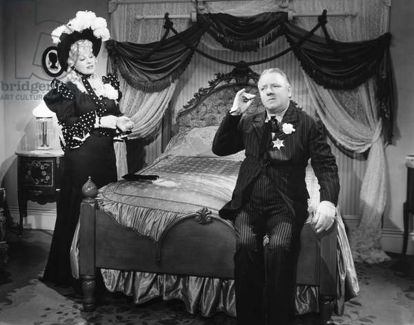 MY LITTLE CHICKADEE, 1940 Film still with Mae West as Flower Belle Lee and W.C. Fields as Twillie.