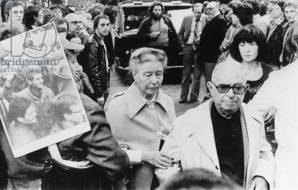 JEAN-PAUL SARTRE (1905-1980) French philosopher, novelist, and dramatist. Sartre (front, center) and Simon de Beauvoir attending the funeral of the author and activist Paul Goldman at Paris, 1979.