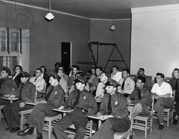 ELLIS ISLAND, c.1943 Detention officers attending an immigration class at Ellis Island. Photograph, c.1943.