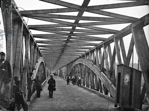 CIVIL WAR: CHAIN BRIDGE Union soldiers on the Chain Bridge over the Potomac River in Washington, D.C. Photograph by William Morris Smith, 1865.