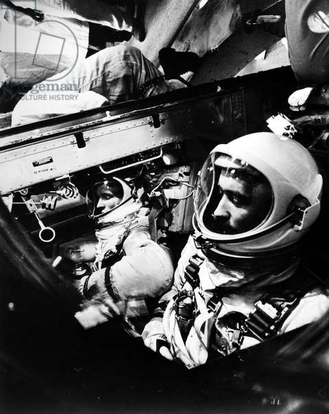 GEMINI IV: ASTRONAUTS, 1965 Astronauts James McDivitt (foreground) and Edward White are secured in the Gemini IV spacecraft before launch on 3 June 1965.