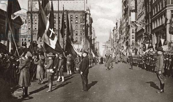 WORLD WAR I: CELEBRATION Ceremony saluting the Allied flags outside of the New York Public Library celebrating the signing of the Armistice, New York. Photograph, 1918.
